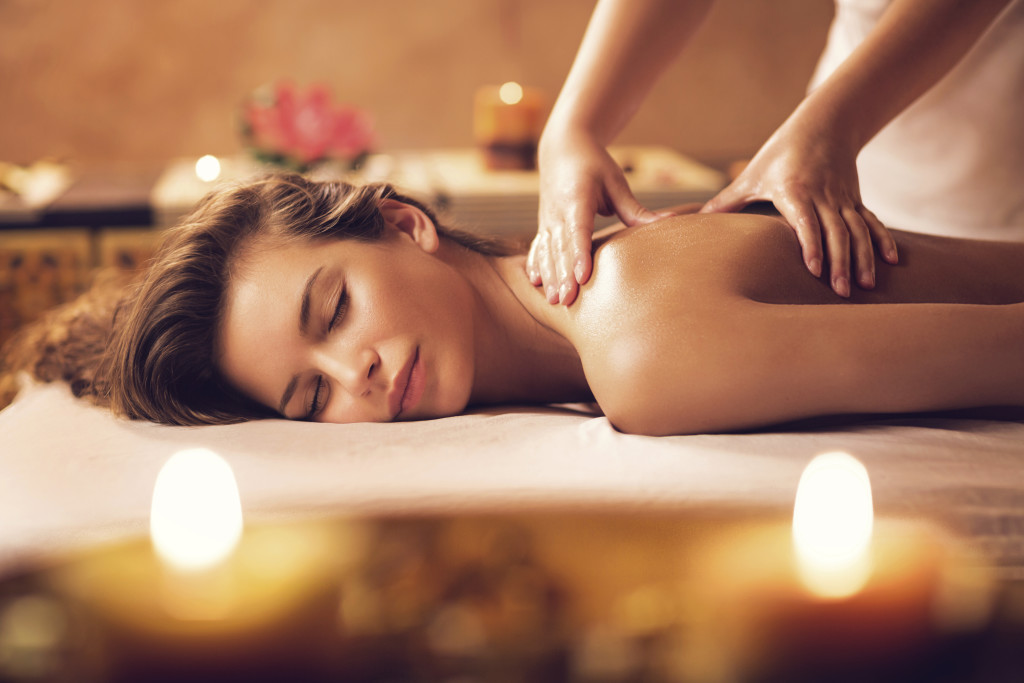 Beautiful woman receiving back massage at the spa.